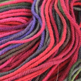 Unisono Sock Yarn Reds/Purples