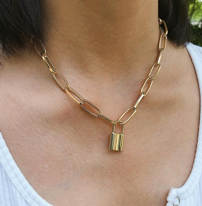 Large oval gold chain with large padlock pendant.