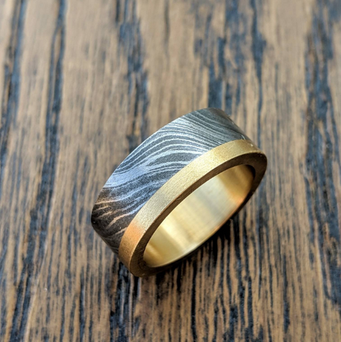 Damascus steel ring with brass
