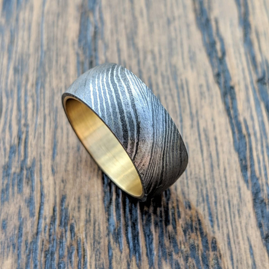 Damascus steel ring brass liner