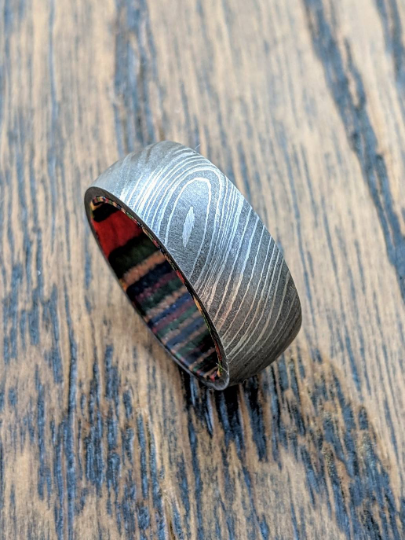 Damascus steel with a wood liner