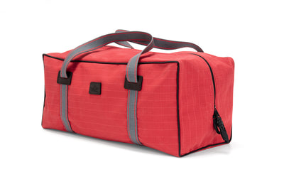 The Angus Barrett Small Canvas Gear Bag in red