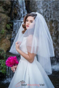 cut-edge-two-tier-white-puffy-tulle-bridal-veil-fingertip-length