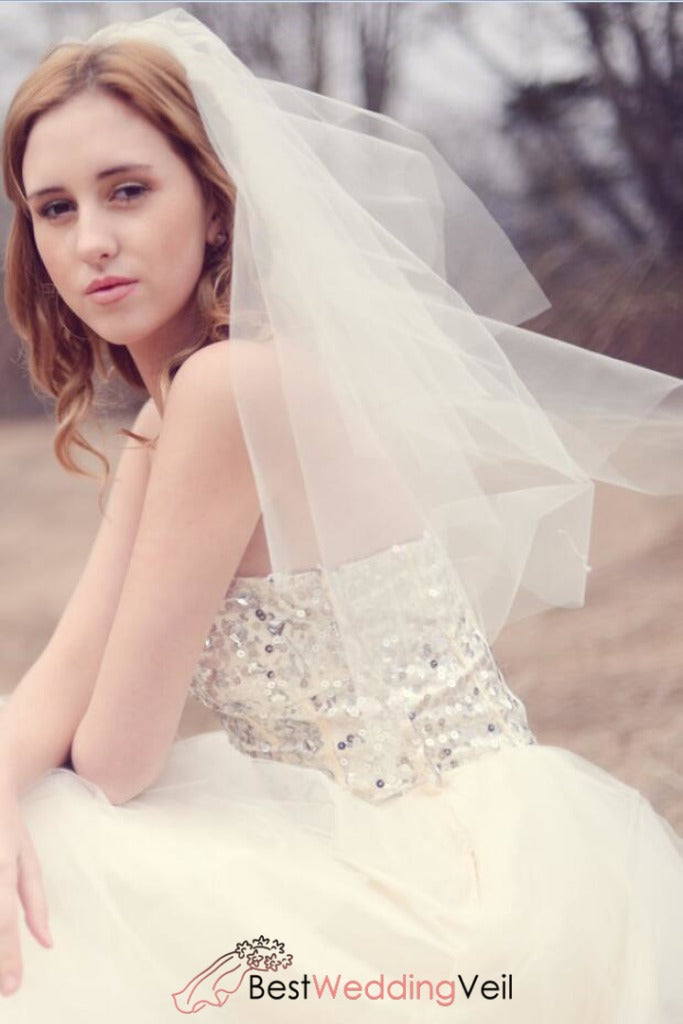 diamond-cut-edge-waist-length-bride-veil-comb