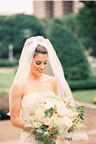 elbow-types-of-wedding-veil-puffy-tulle-cut-edge