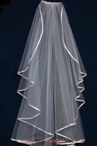 long-waterfall-wedding-veil-with-ribbon-edge-in-light-blush