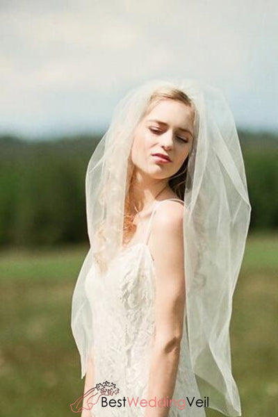 mid-hip-length-tulle-ivory-veil-wedding-cut-edge