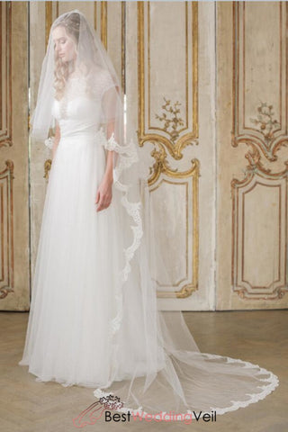 two-tier-semi-lace-edged-ivory-wedding-veil-cut-edge-blusher