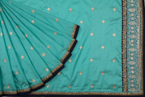Trisha's Mesmerizing Turquoise Colored Party Wear Saree