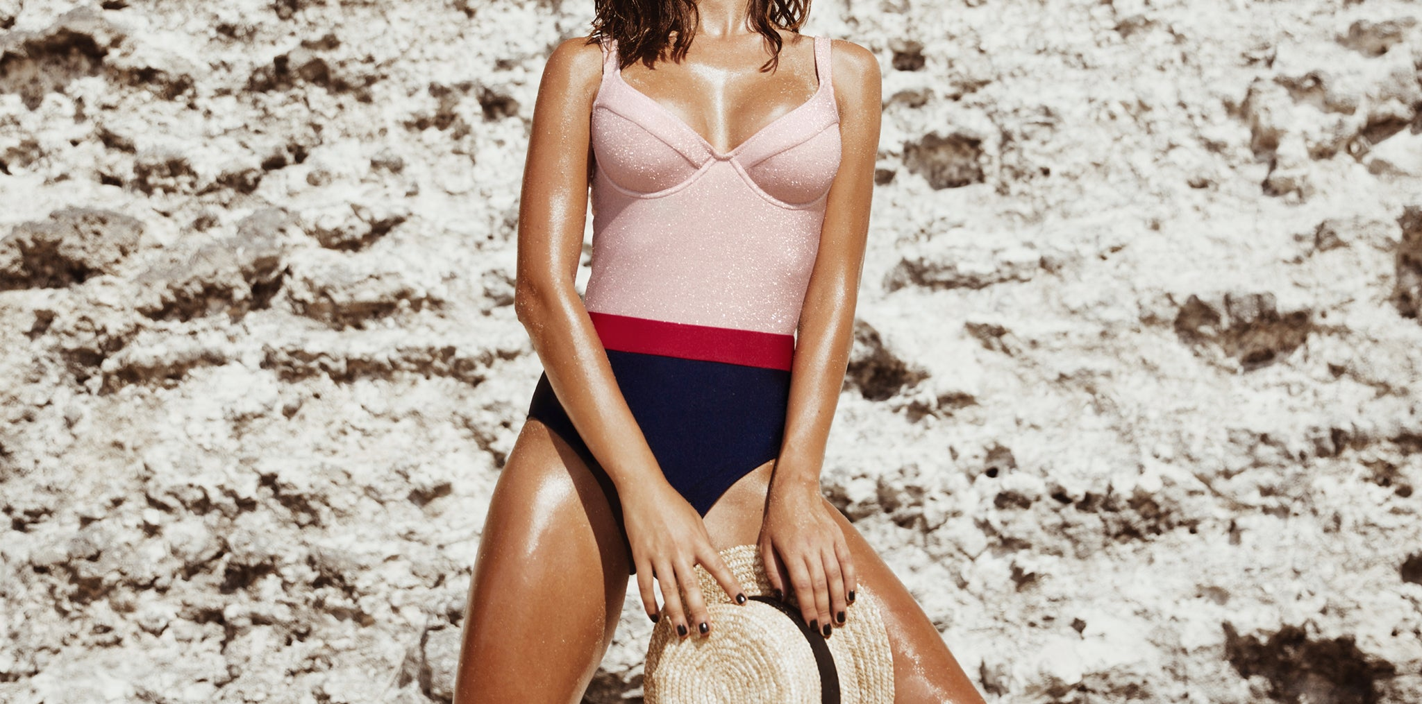 Indaia Swim take on the nautical trend in this iconic one piece mixing pink lurex with red and navy shiny lycra