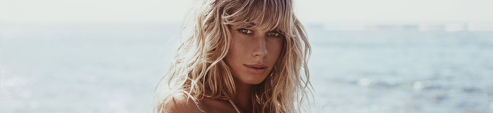 Indaia Swim's muse Madeline Relph showing her Australian native beauty with salty blonde hair at the beach