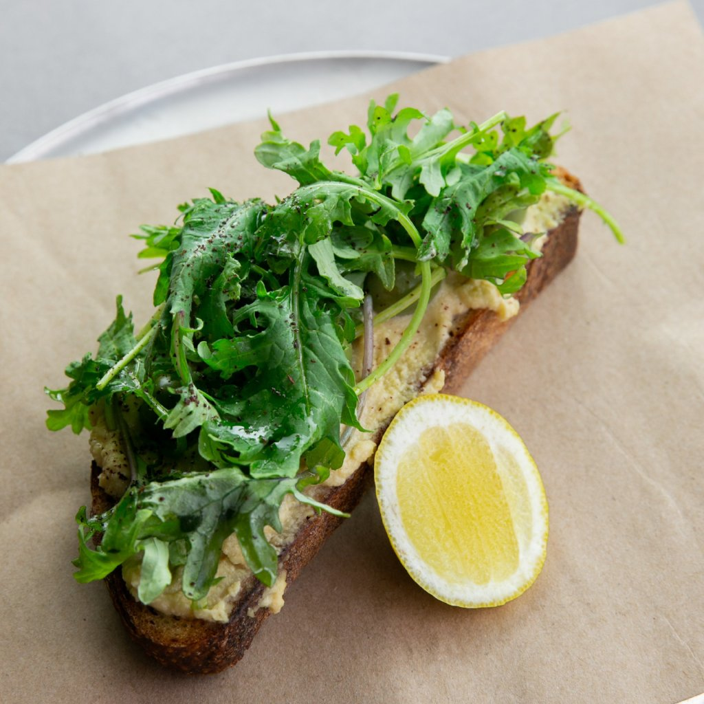 Toast with Hummus, Olives, Baby Kale & Lemon
