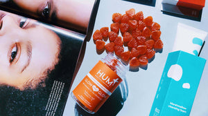 Hum Nutrition Glow Sweet Glow gummies spilling out of contain with Enature Marshmallow cleansing foam