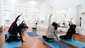 Yoga Instructor Kate Diaz leading a class in restful yoga