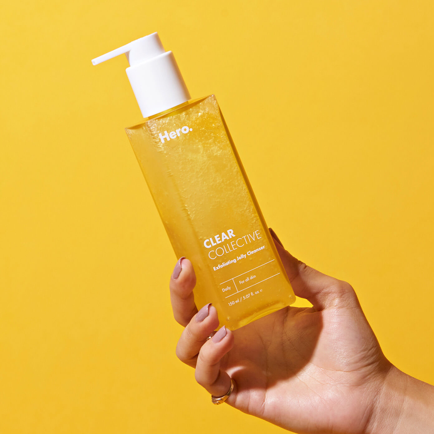 Hand holding the Clear Collective Exfoliating Jelly Cleanser