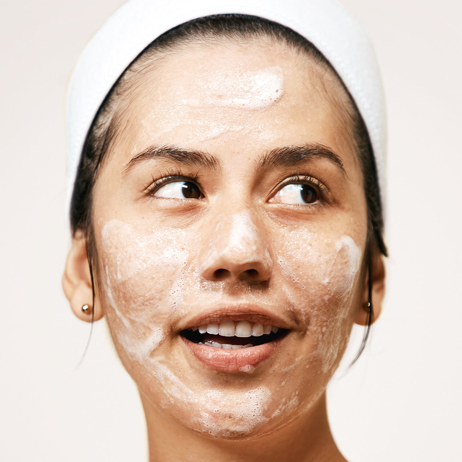 Woman using Exfoliating Jelly Cleanser