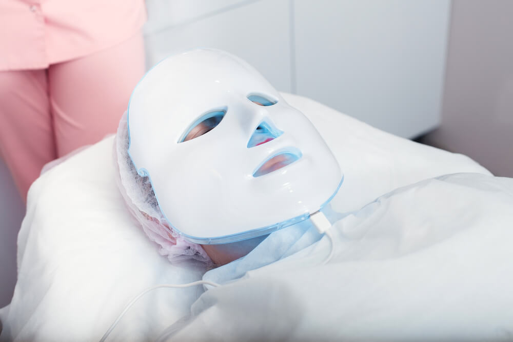 person receving blue light therapy treatment