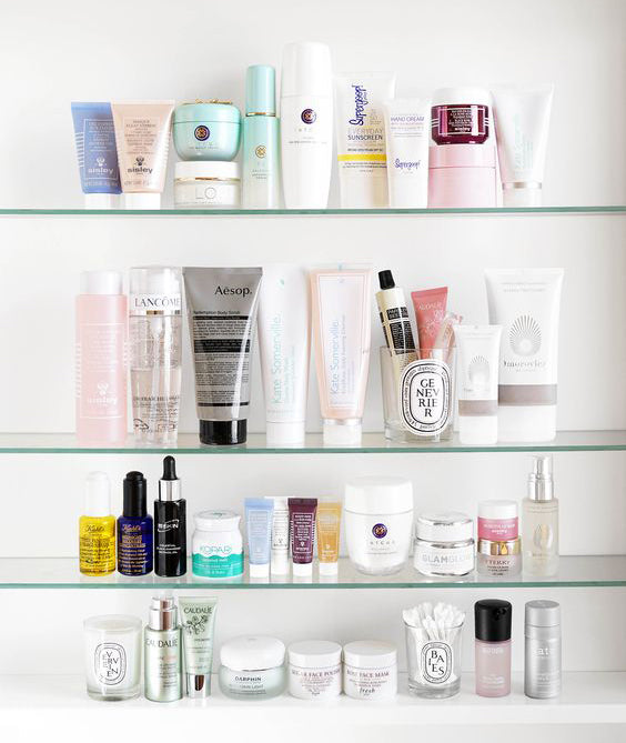 cabinet shelf with a huge variety of skincare products