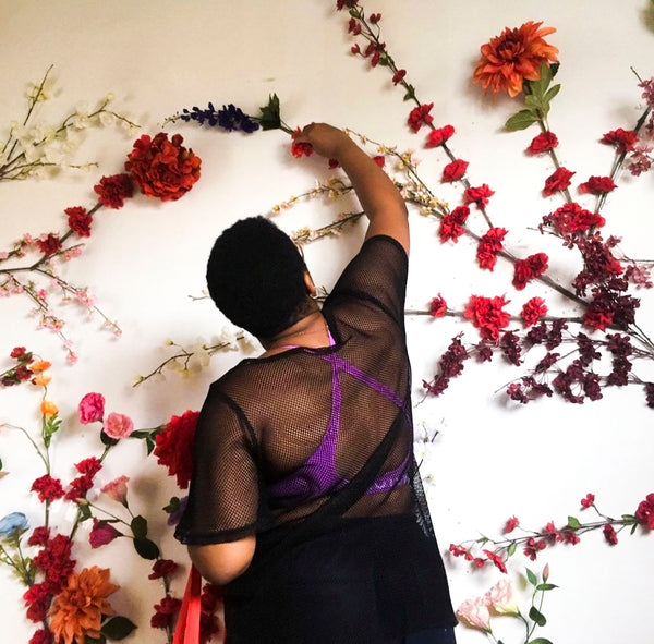 Shanika creating a floral installation