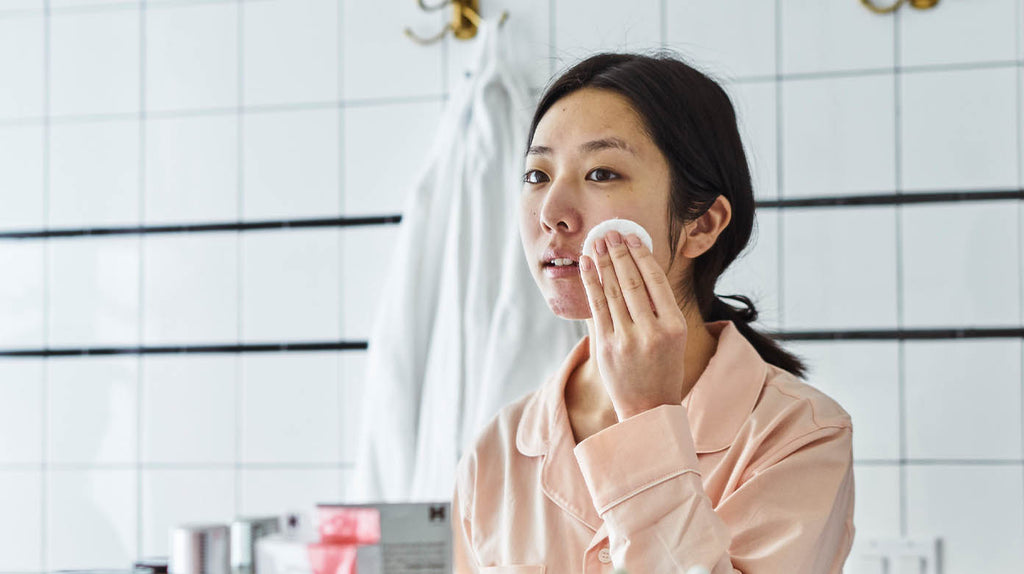 woman using chemical exfoliant
