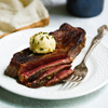 New York Strip with Whipped Herb Butter