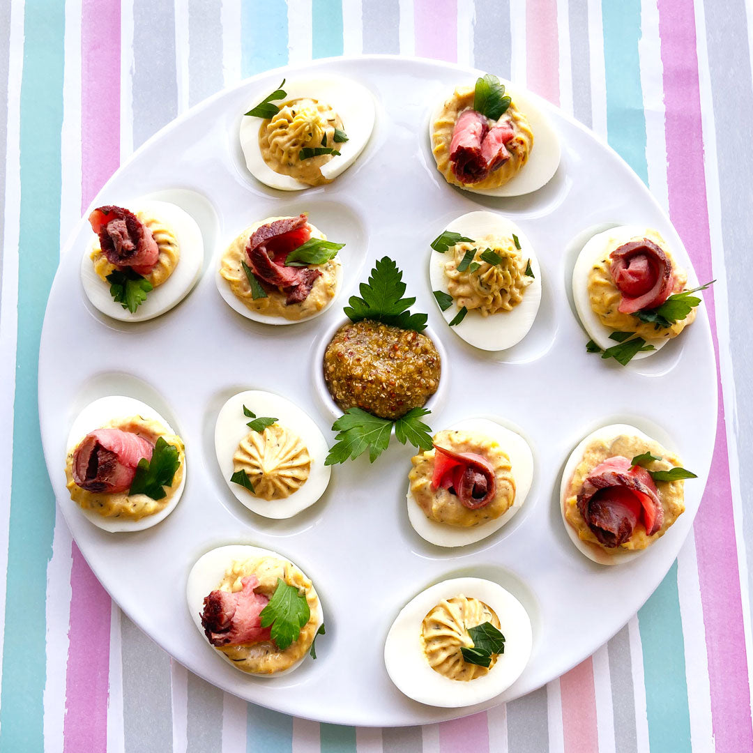 Deviled Eggs on a plate with a colorful table cloth