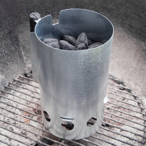 charcoal chimney sitting in the bottom of a grill