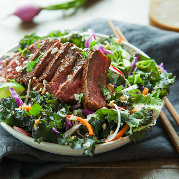 A steak salad on the table