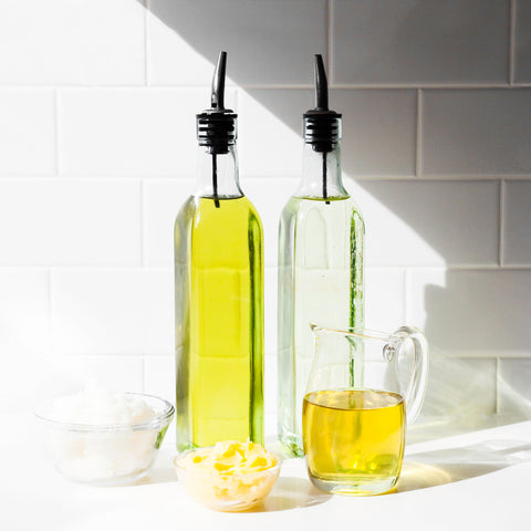 Different cooking oils like olive oil or grapeseed oil. Used as fat in cooking.