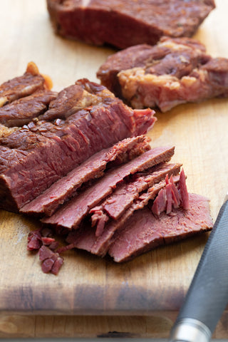 corned beef sliced on a cutting board