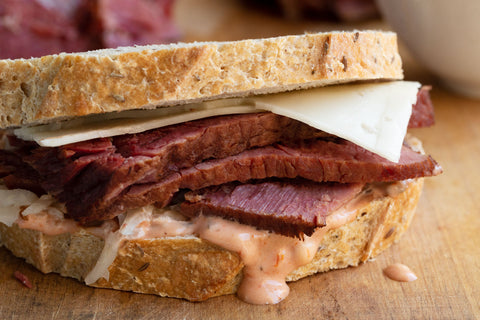corned beef sandwich with homemade thousand island dressing and swiss cheese