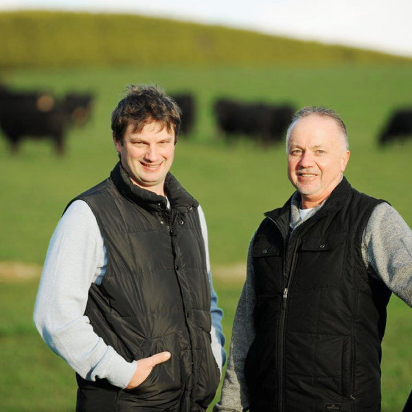 2 Famers with cattle in the field