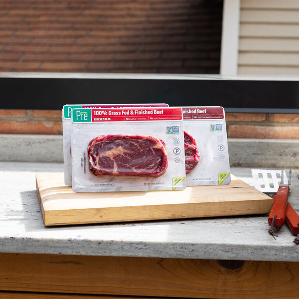 3 steak packages of Pre beef near a grill