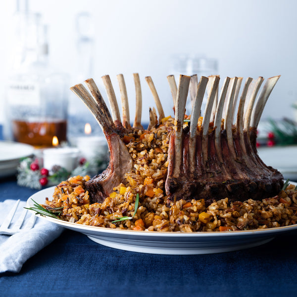Rack of Lamb on dining table with pomegranate sauce