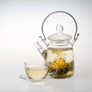 Teaposy falling water tea blooming in the tea for one glass teapot, with a soul-mates glass cup and saucer set