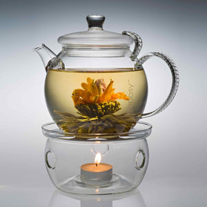 Teaposy dream posy set showing heart of love tea blooming in the daydream glass teapot on the light my fire tea warmer
