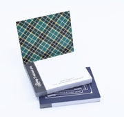 """Sorry I missed you"" brothers ministry sticky notepad. Dark cover, navy and green plaid on inside, with blank paper."