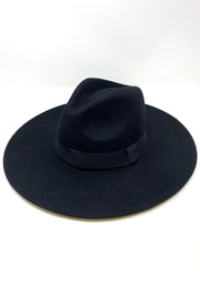 THE LADY IN BLACK BRIMMED HAT