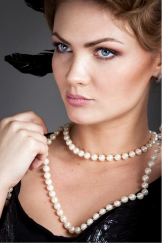 Woman with cultured pearl necklace
