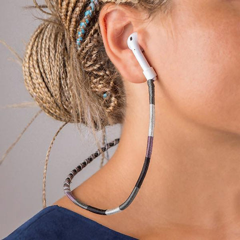 blond hair woman wearing  airpods and airpods strap