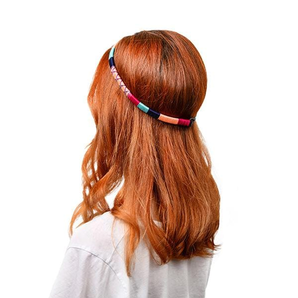girl with orange hair wears colorful headband