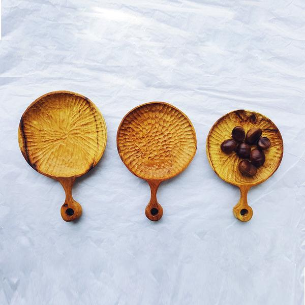 Three Mulberry wood hand-carved plates one with chestnut