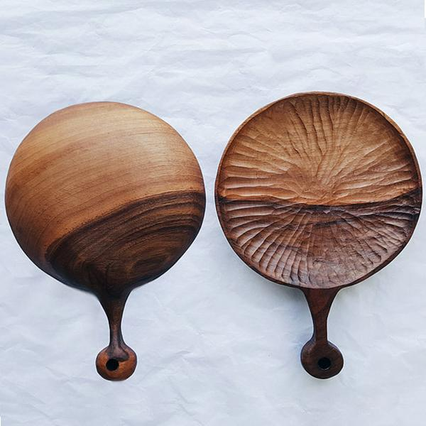 Walnut wood hand-carved plates with texture