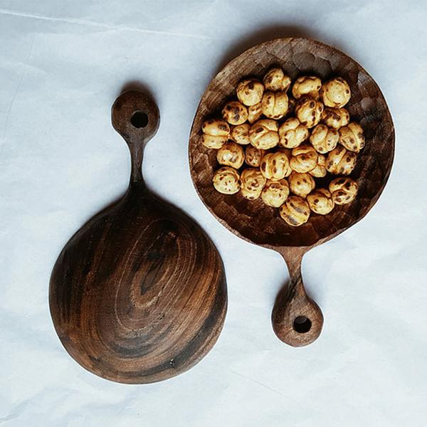 Two Walnut wood hand-carved spoons with roasted chickpeas in them