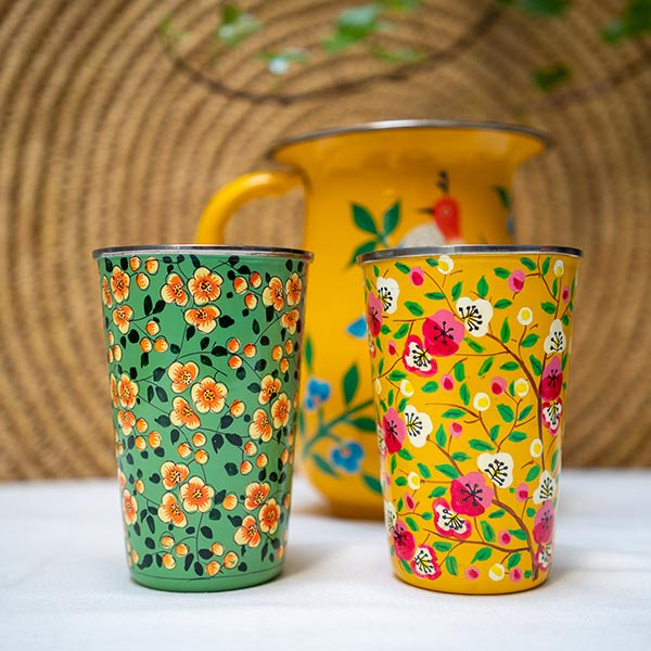 Colourful enamelware jug and tumblers