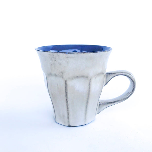 handmade ceramic blue latte colour tea and coffee cup at hippist