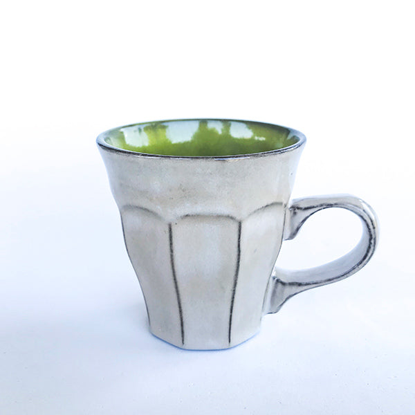 handmade ceramic green latte colour tea and coffee cup at hippist