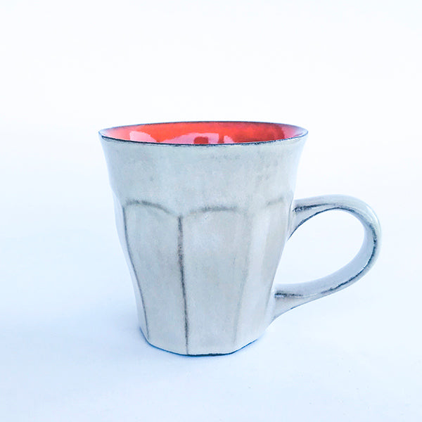 handmade ceramic orange latte colour tea and coffee cup at hippist