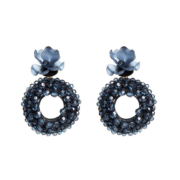 ponponiere branded navy coloured bead detailed ring and plexi flower-shaped earrings