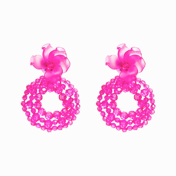 fuschia colour bead detailed ring and plexi flower-shaped earrings